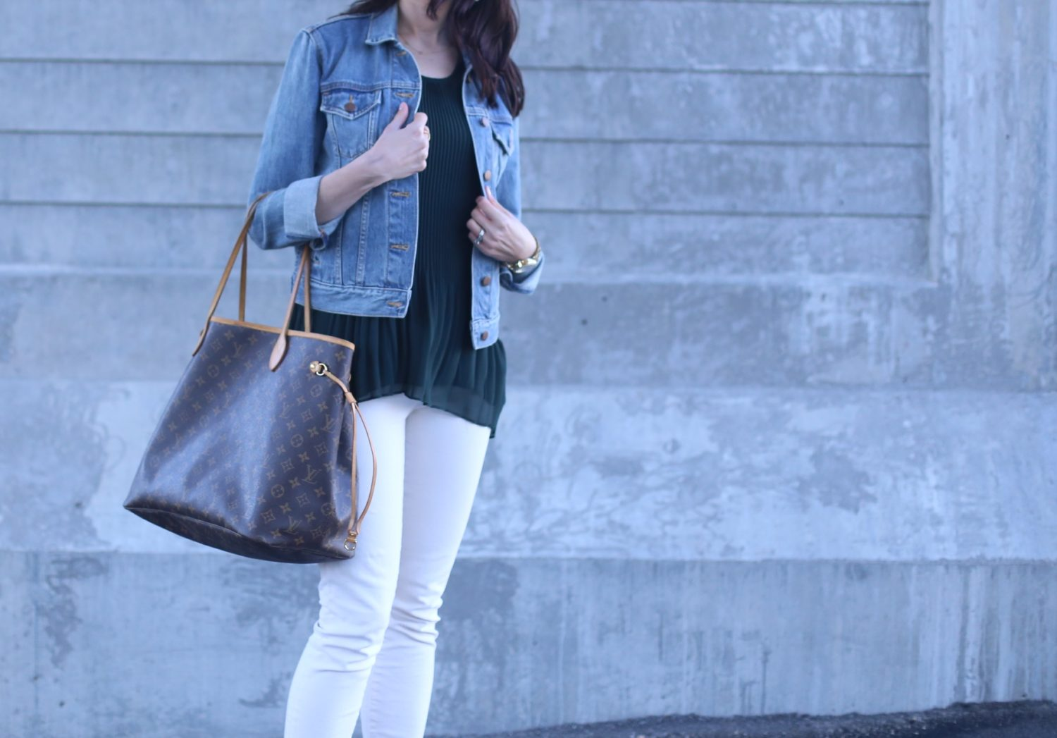 Louis Vuitton bag, skinny jeans in ecru, peplum top
