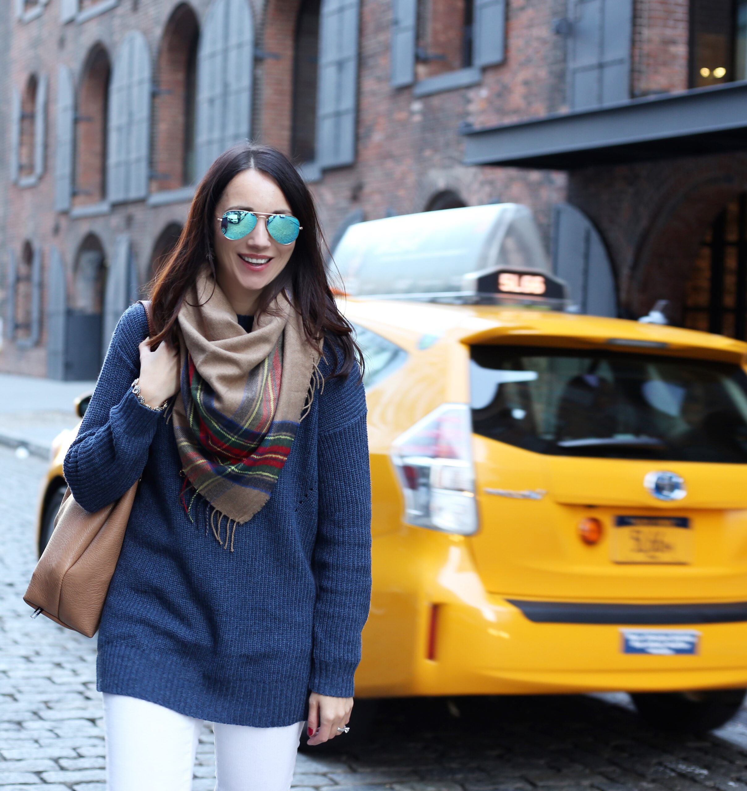 blogger Anna Monteiro of Blushing Rose Style wearing mock neck sweater, BP. plaid scarf and white J.Crew toothpick denim