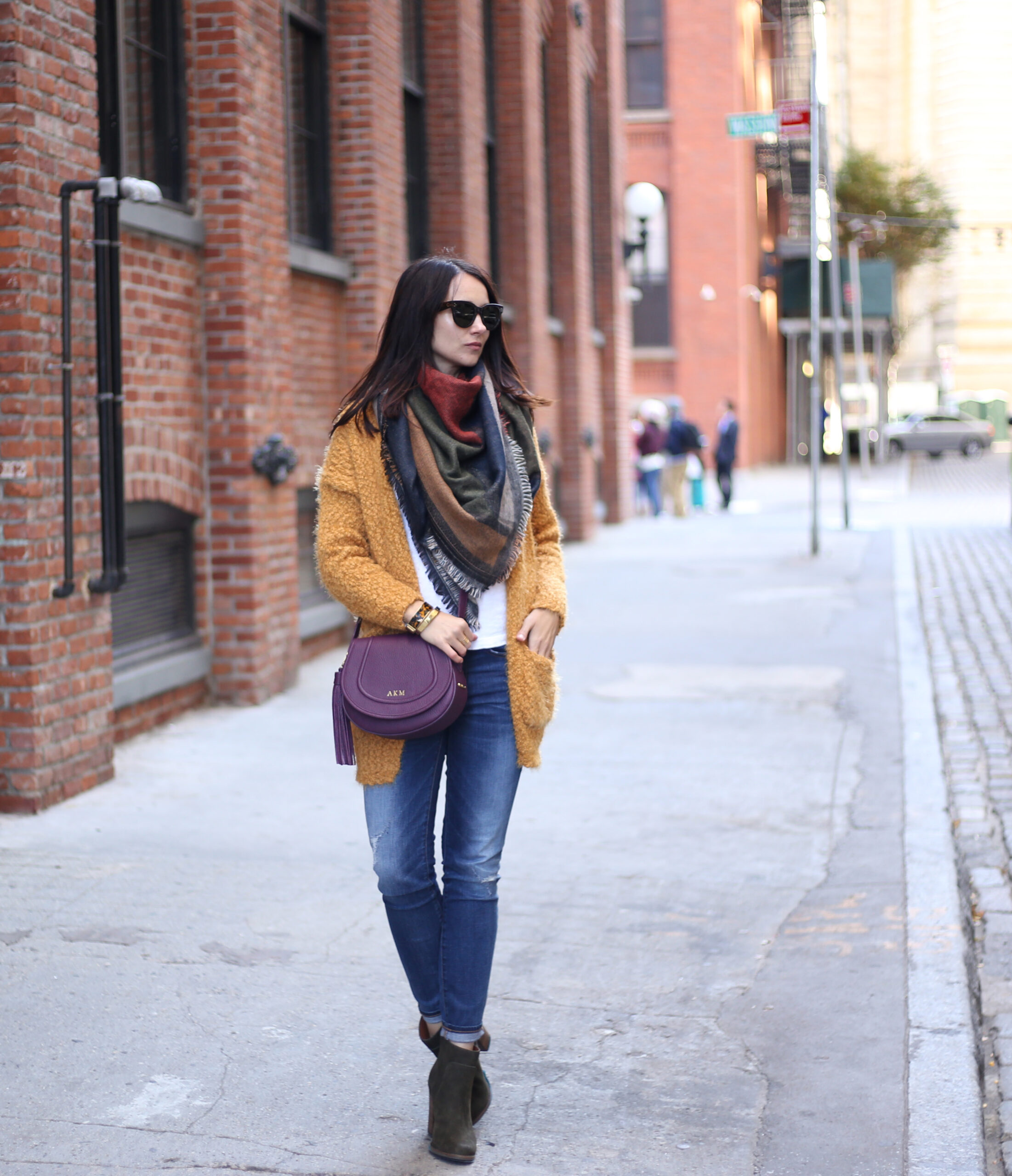 fashion blogger Anna Monteiro of blushing rose style blog wearing yellow open front cardign, BP scarf from Nordstrom and a gigi new york bag
