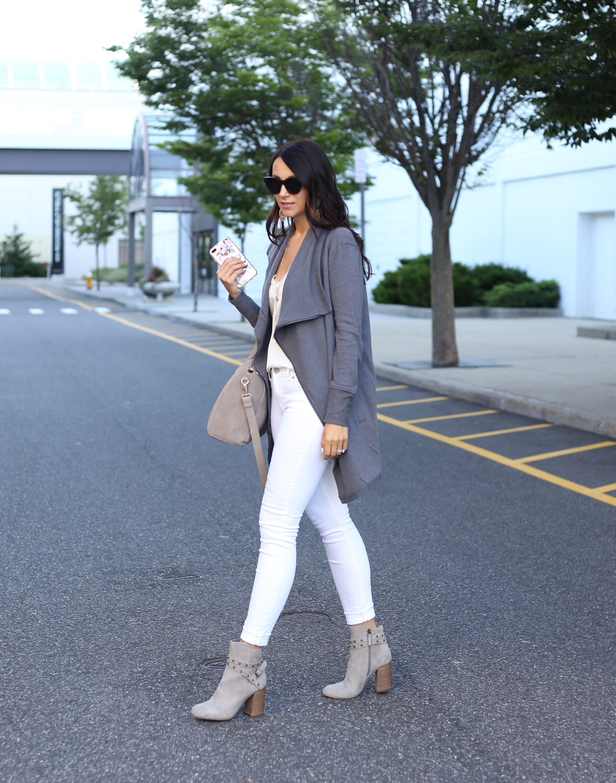 blogger Anna Monteiro of Blushing Rose STyle fashion blog wearing grey BP. booties from the Nordstrom Anniversary Sale 2017 and white jeans