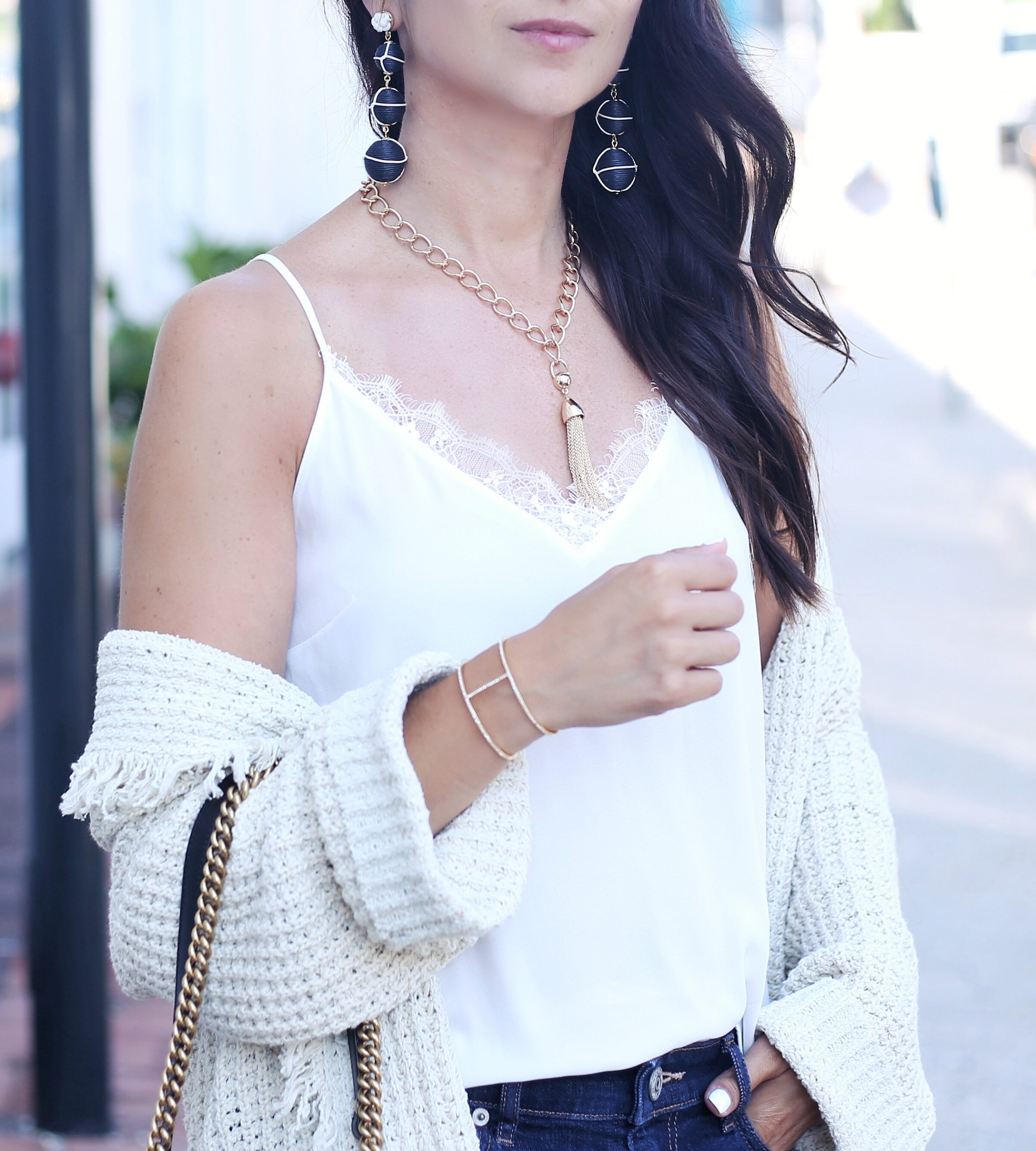 blogger Anna Monteiro of blushing rose style blog wearing babublebar drop earrings and tassel necklace