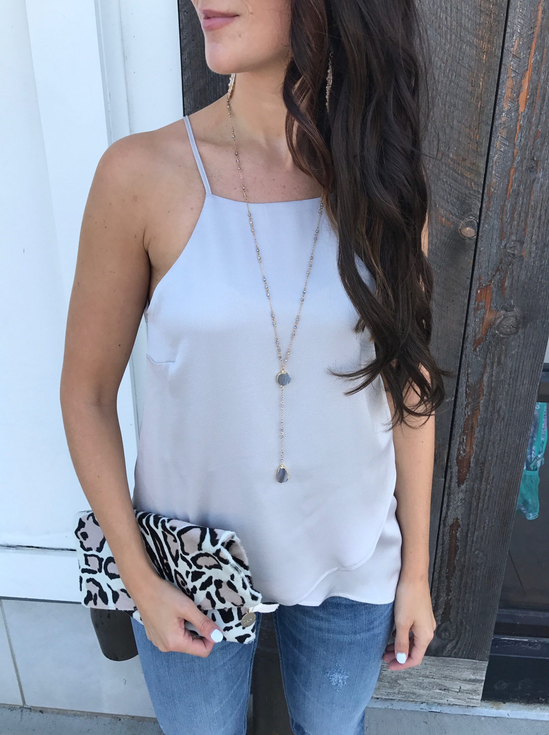 fashion blogger Anna Monteiro of blushing rose style blog wearing lush tulip camisole from nordstrom and clare v leopard clutch in fall wardrobe update