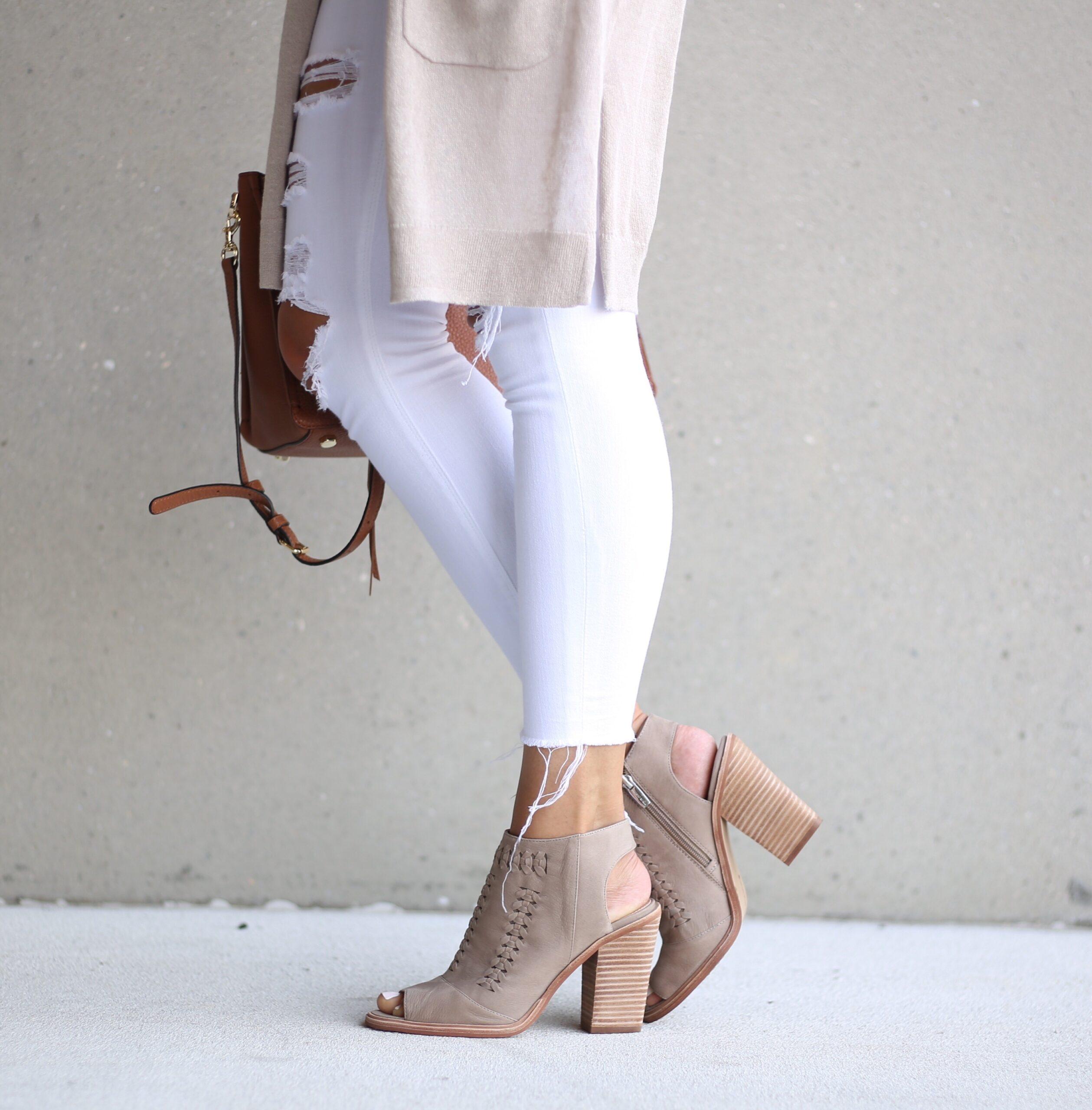 blogger Anna Monteiro of Blushing Rose Style wearing Vince Kamuto booties