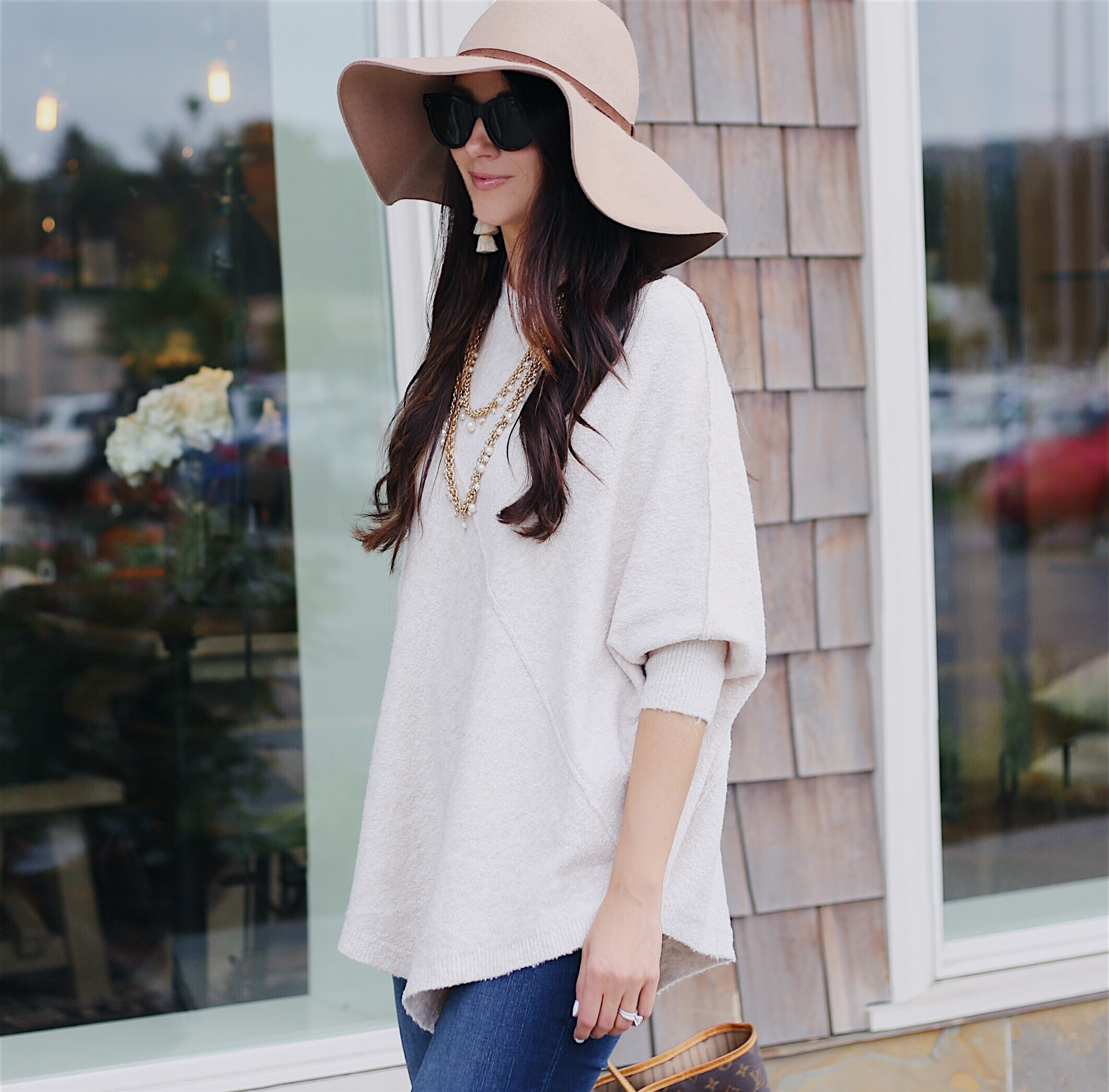 Blogger Anna Monteiro of Blushing Rose Style wearing cute fall outfit, poncho, floppy hat and over the knee boots
