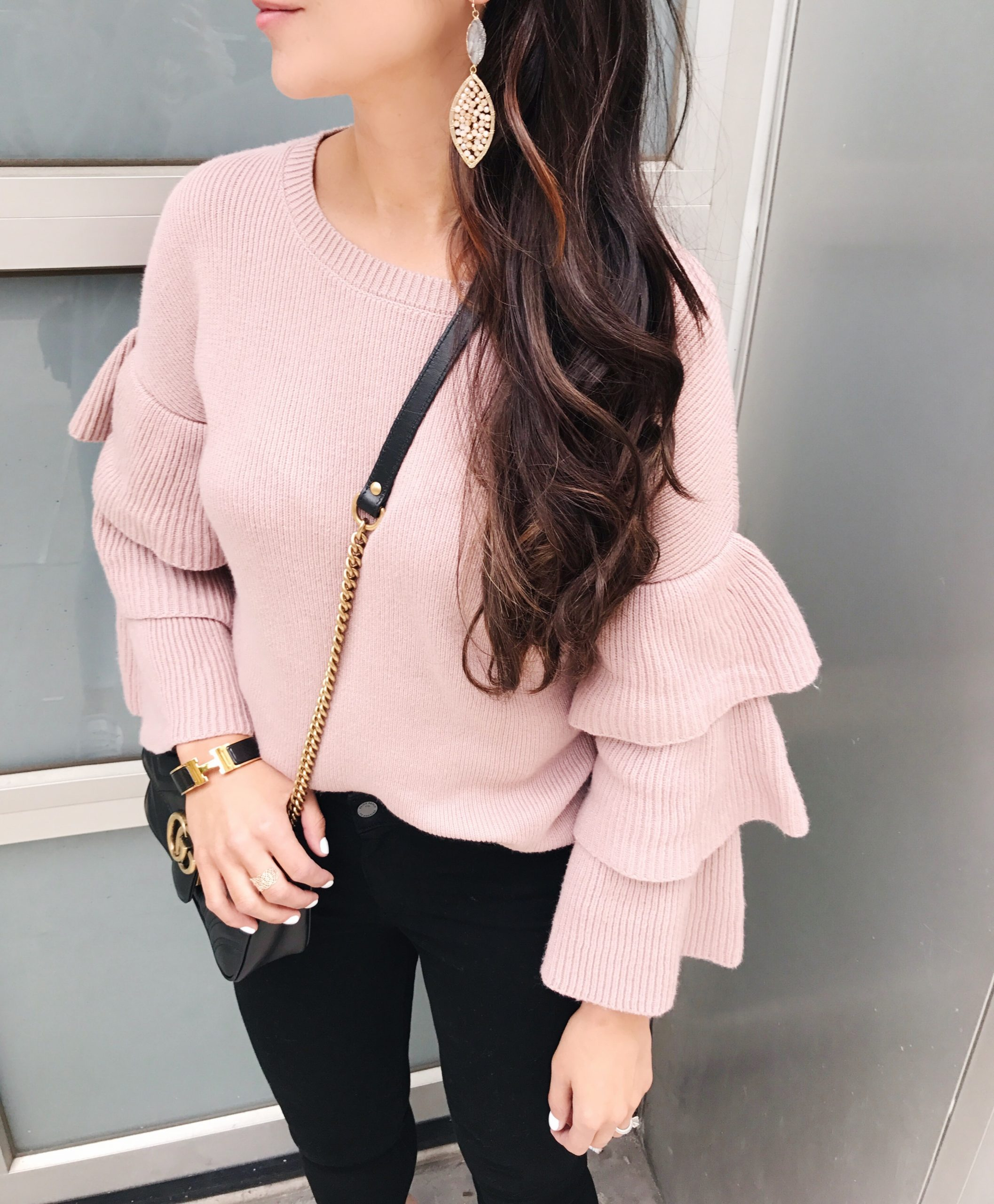 blogger Anna Monteiro of blushing rose style wearing pink halogen sweater with ruffle sleeves and a great pair of jean from nordstrom