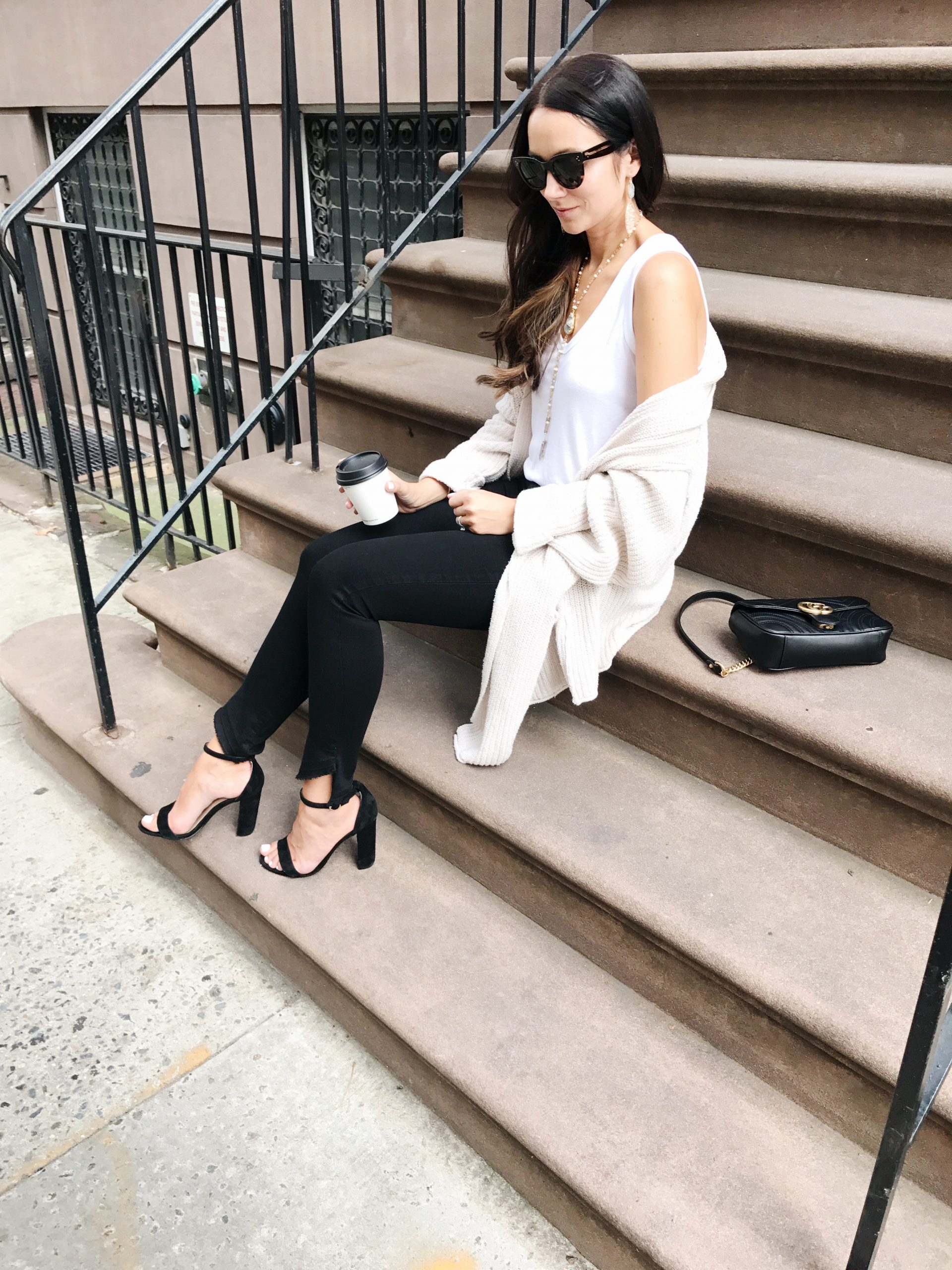 blogger Anna Monteiro of Blushing Rose Style blog wearing Steve Madden block heel sandals and great pair of jeans