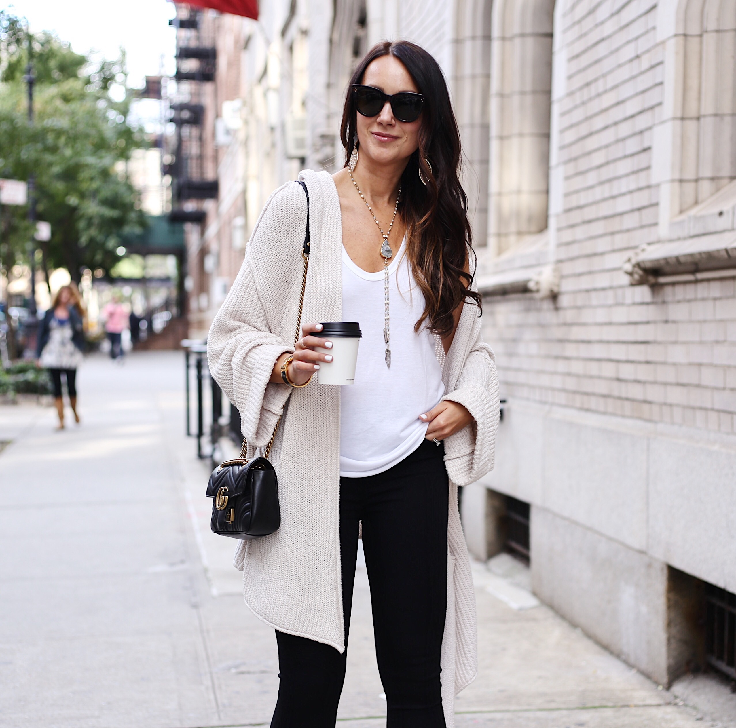 blogger Anna Monteiro of Blushing Rose Style wearing free people chunky cardigan and great pair of jeans