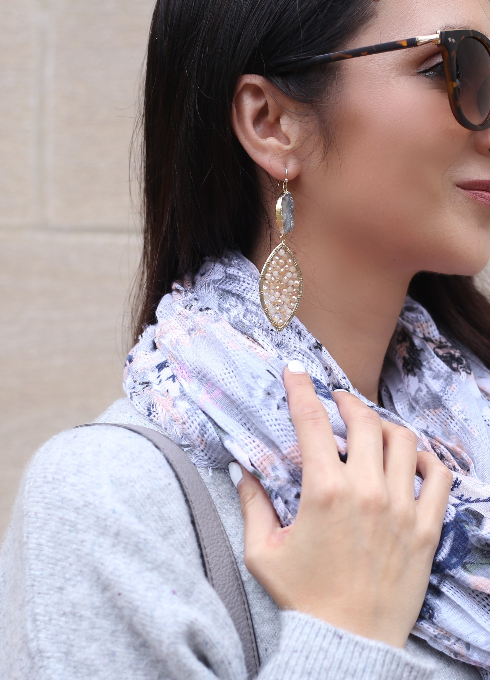 blogger Anna Monteiro of Blushing ROse Style wearing statement earrings in cozy fall sweaters