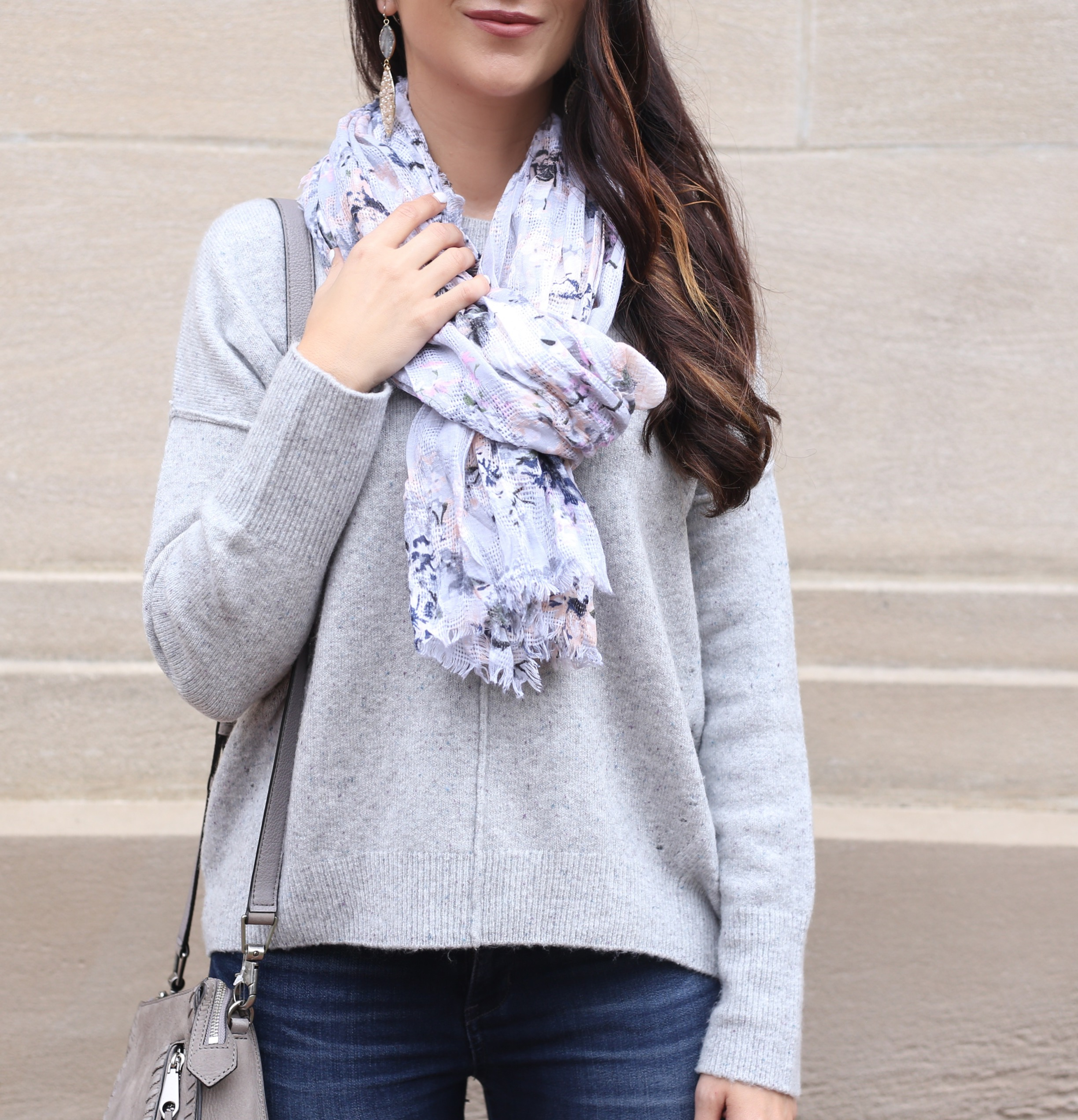 blogger Anna Monteiro wearing cozy fall sweaters and grey slouchy pullover with floral print scarf