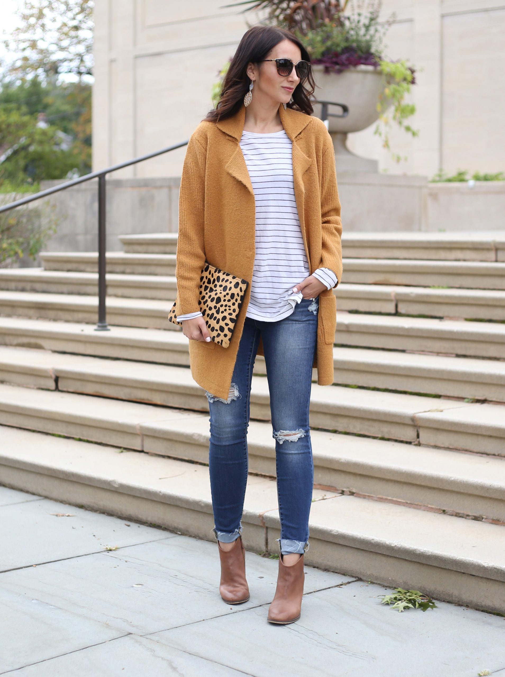 blogger Anna Monteiro of Blushing ROse Style wearing cozy fall sweaters and striped tee with skinny jeans and ankle booties