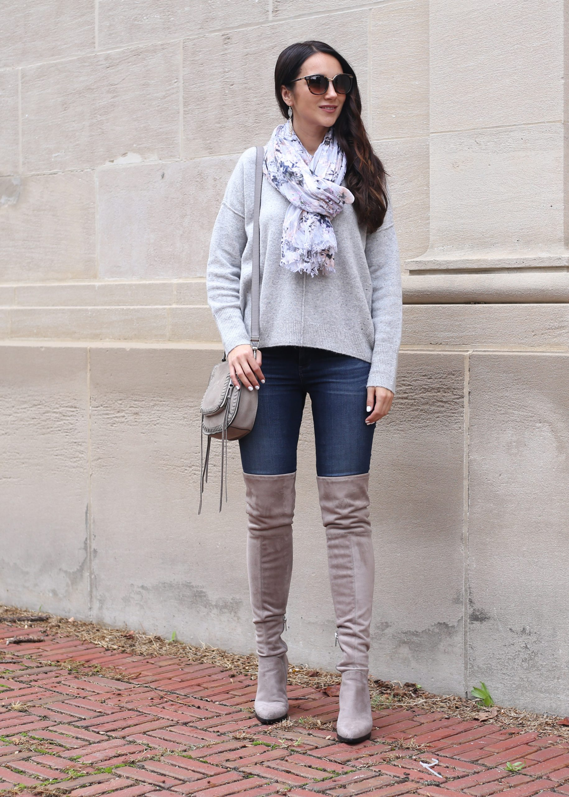 blogger Anna Monteiro of Blushing ROse Style wearing grey over the knee boots and slouchy sweater with skinny jeans in cozy fall sweaters