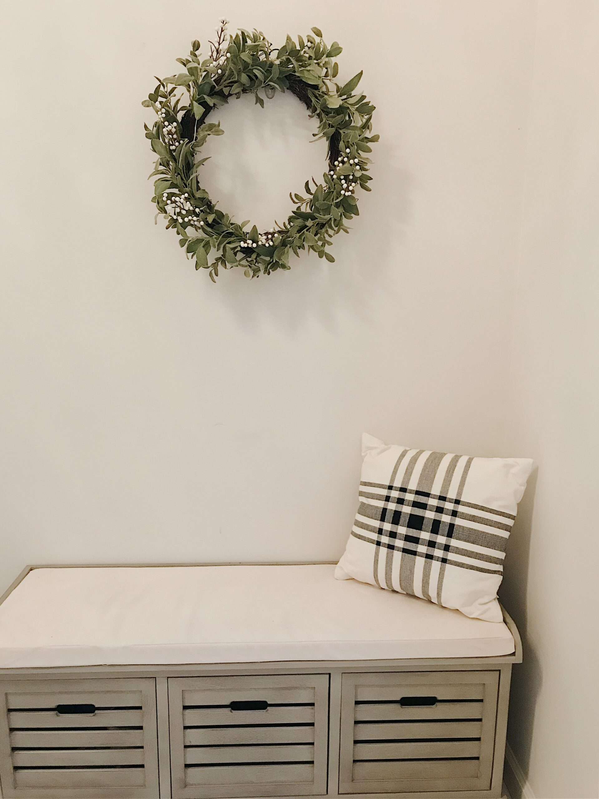 Mudroom bench wreath and plaid pillow