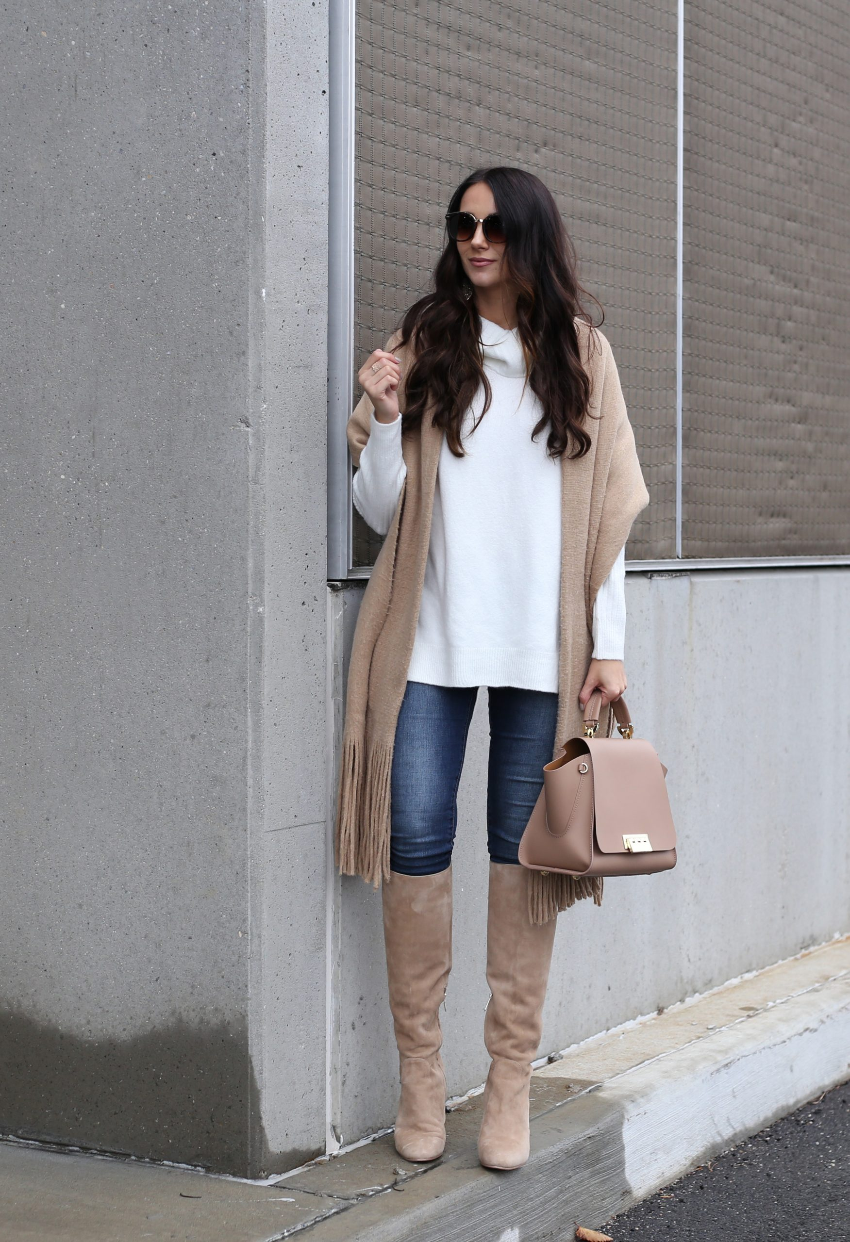 blogger Anna Monteiro of Blushing ROse style wearing chunky scarf tunic sweater and tall boots in casual holiday outfit