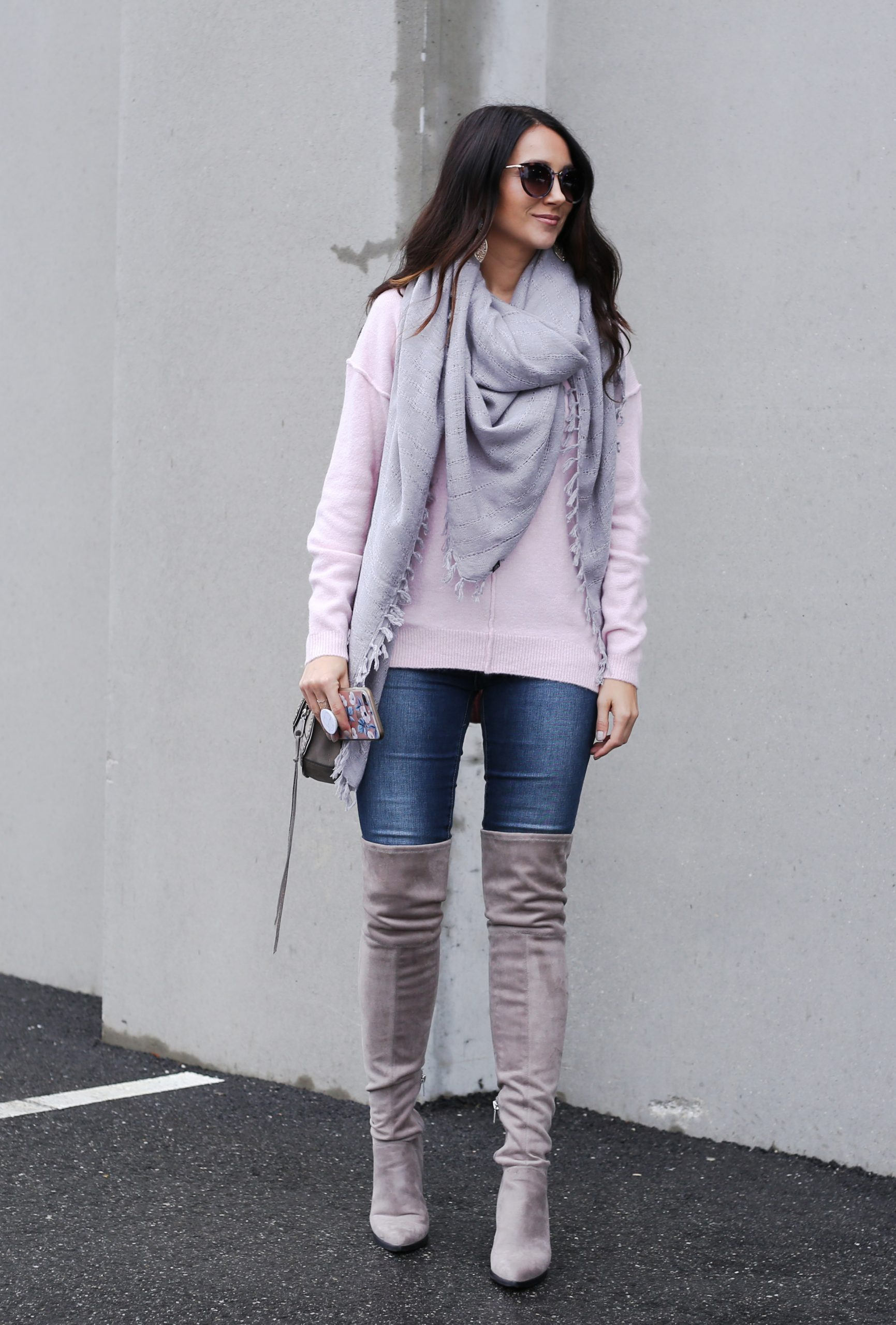 blogger Anna Monteiro wearing over the knee boots in grey blush sweater in casual holiday look