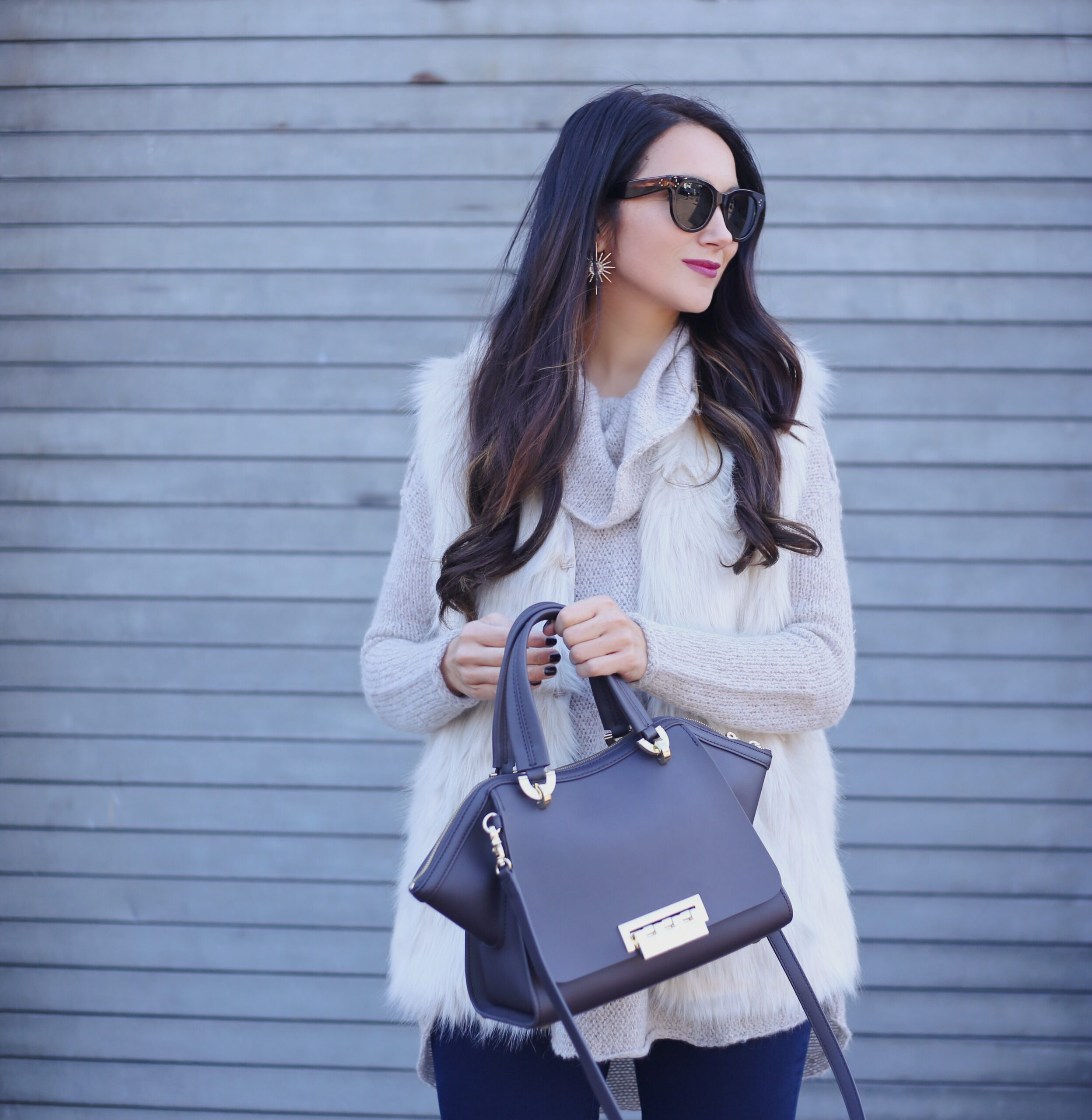 blogger anna monteiro of blushing rose style blog wearing faux fur vest in holiday outfit 3 must have boot styles to own this season