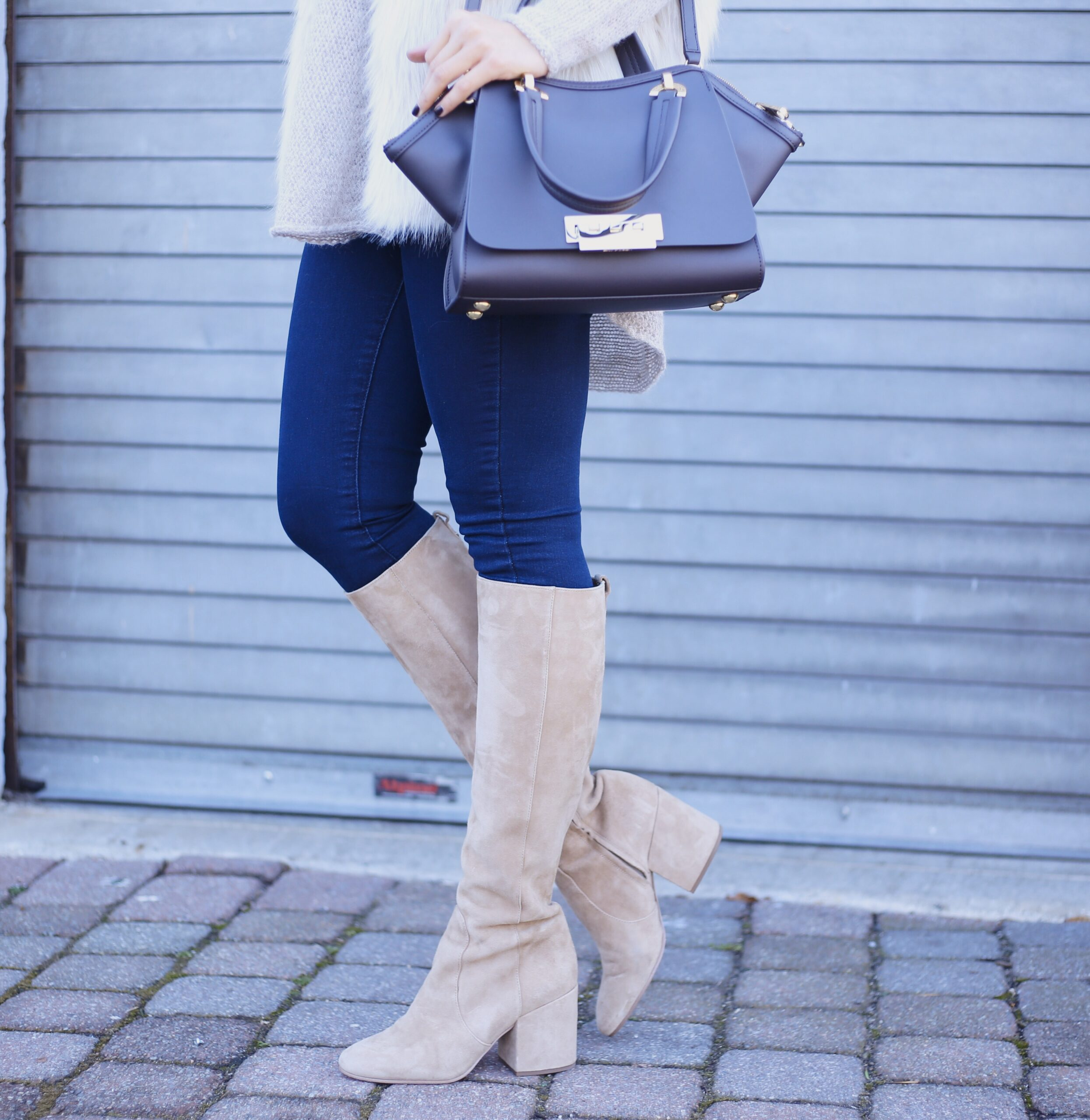 blogger Anna Monteiro of Blushing ROse style wearing knee high boots in 3 must have boots to own this season