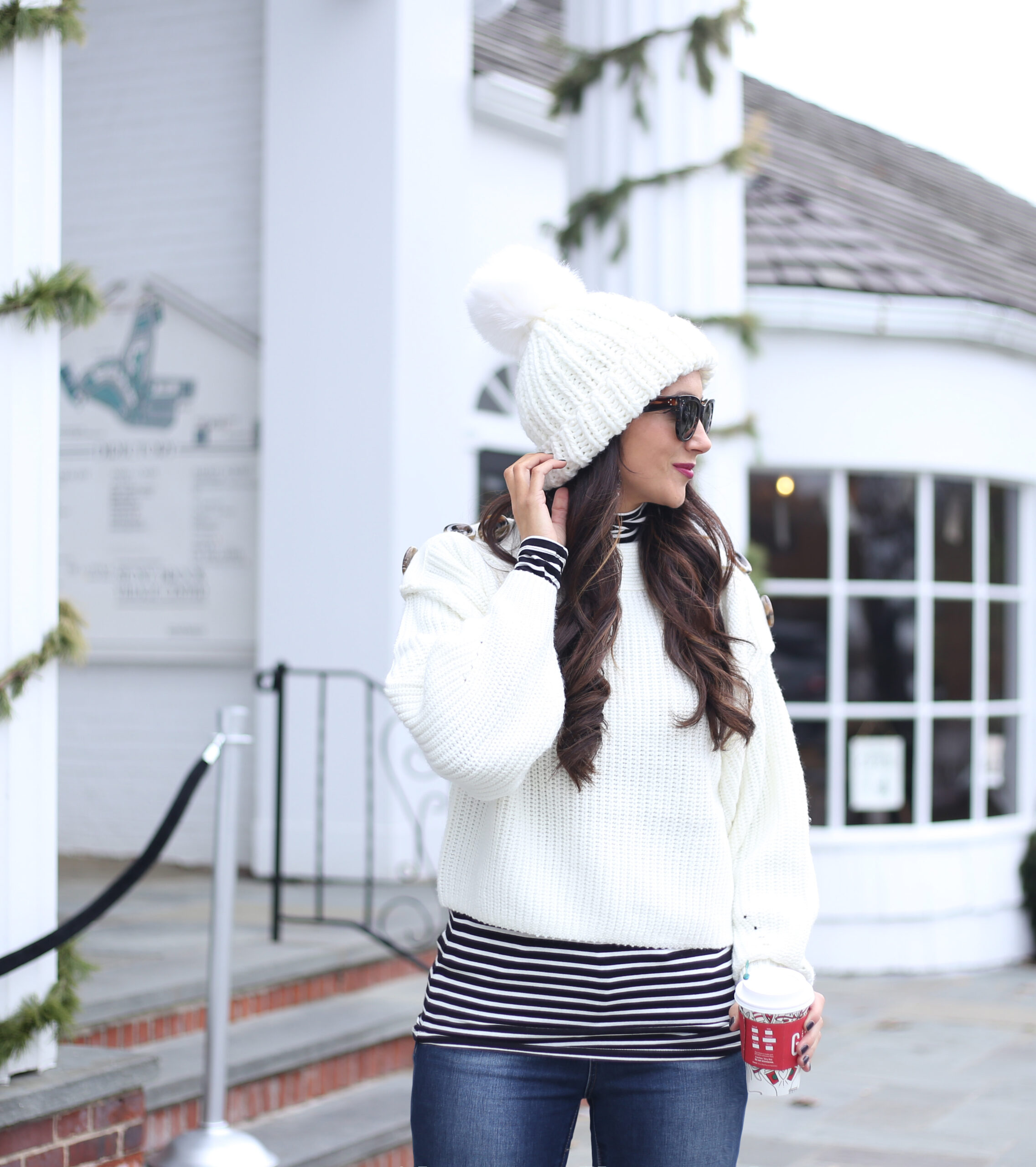 blogger anna monteiro of blushing rose style wearing winter white outfit in 3 must have boot styles to own this season