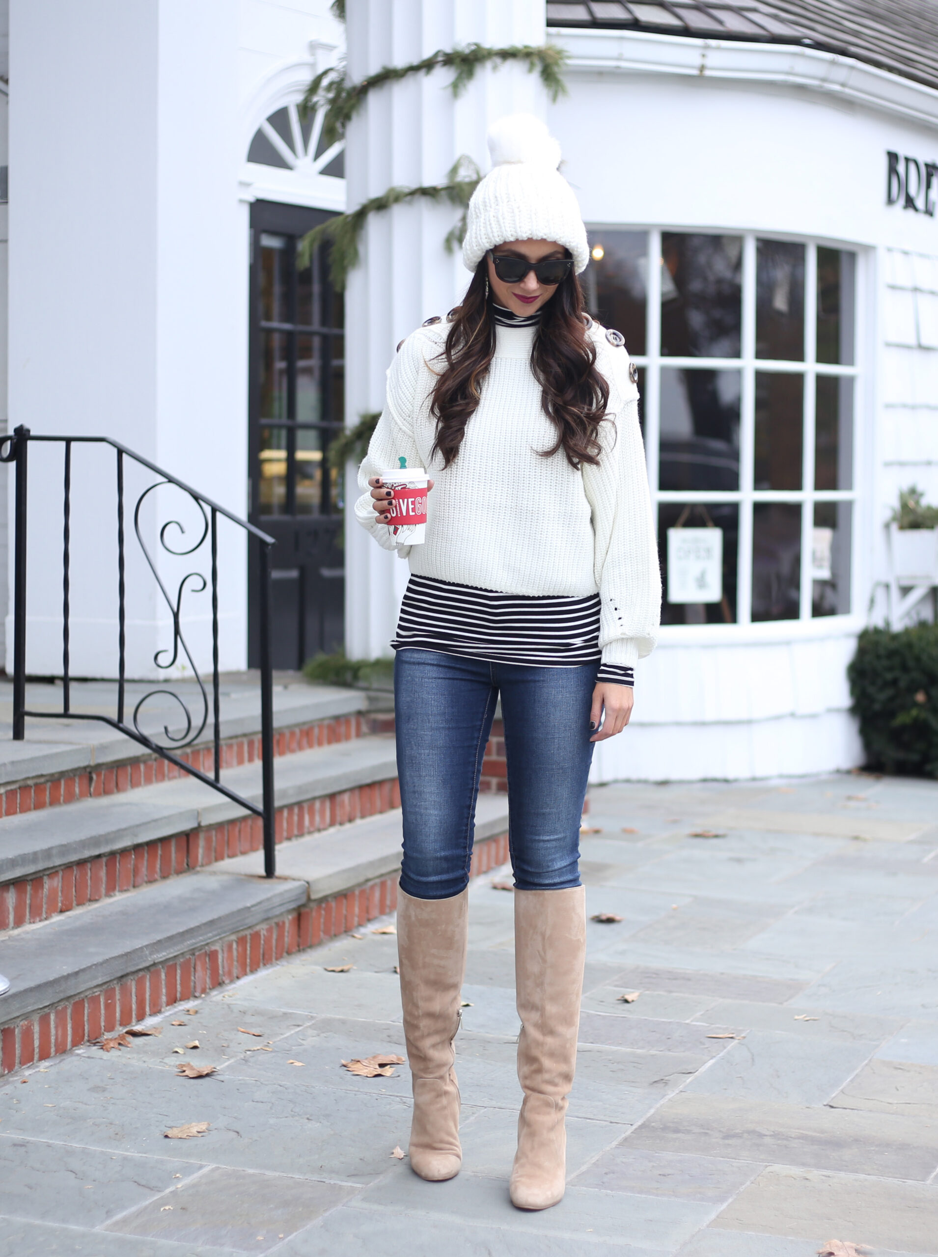 blogger anna monteiro of blushing rose style blog wearing knee high boots and white sweater in 3 must have boot styles to own this season