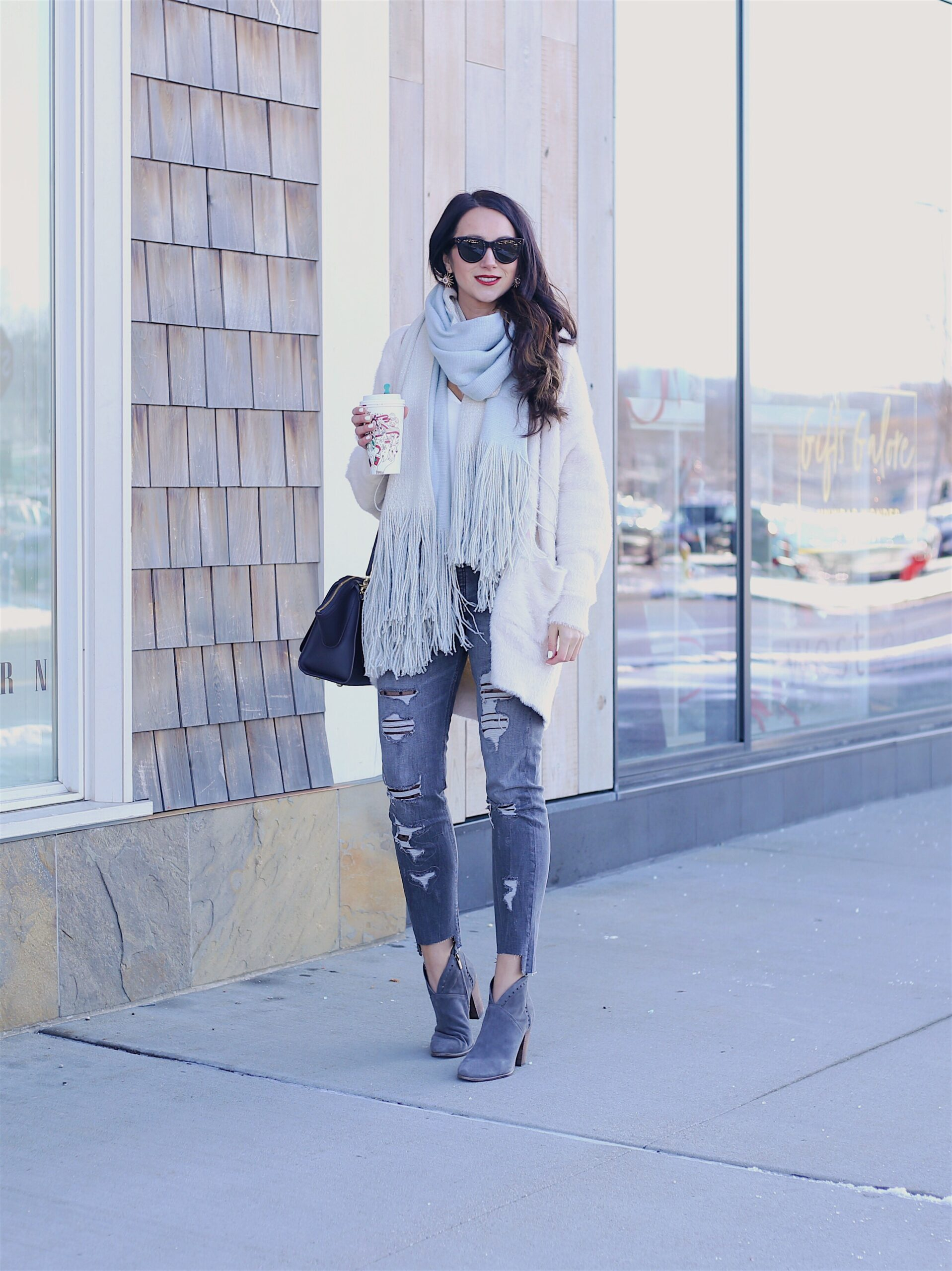 cozy winter layers white cardigan and fringe scarf