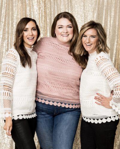Three women wearing a lace crochet top