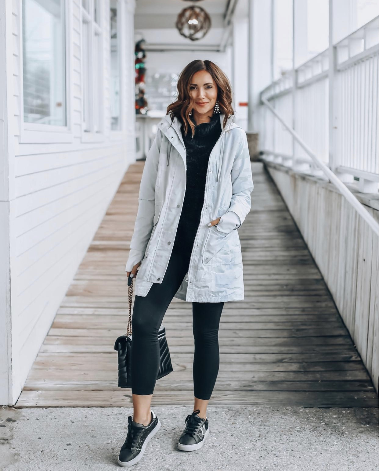 Woman wearing camo rain jacket, athleisure wear