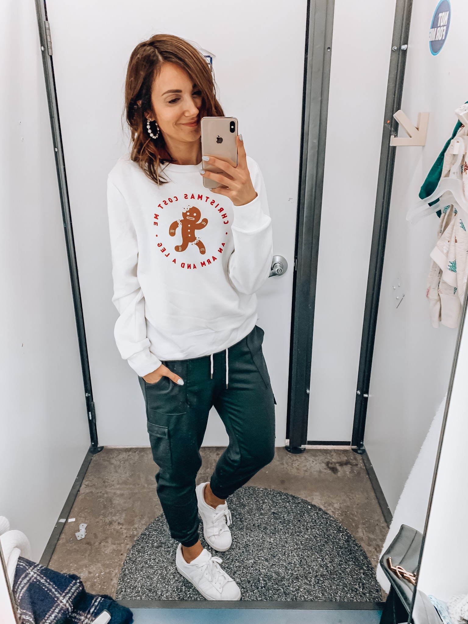 Woman wearing graphic christmas tee and joggers