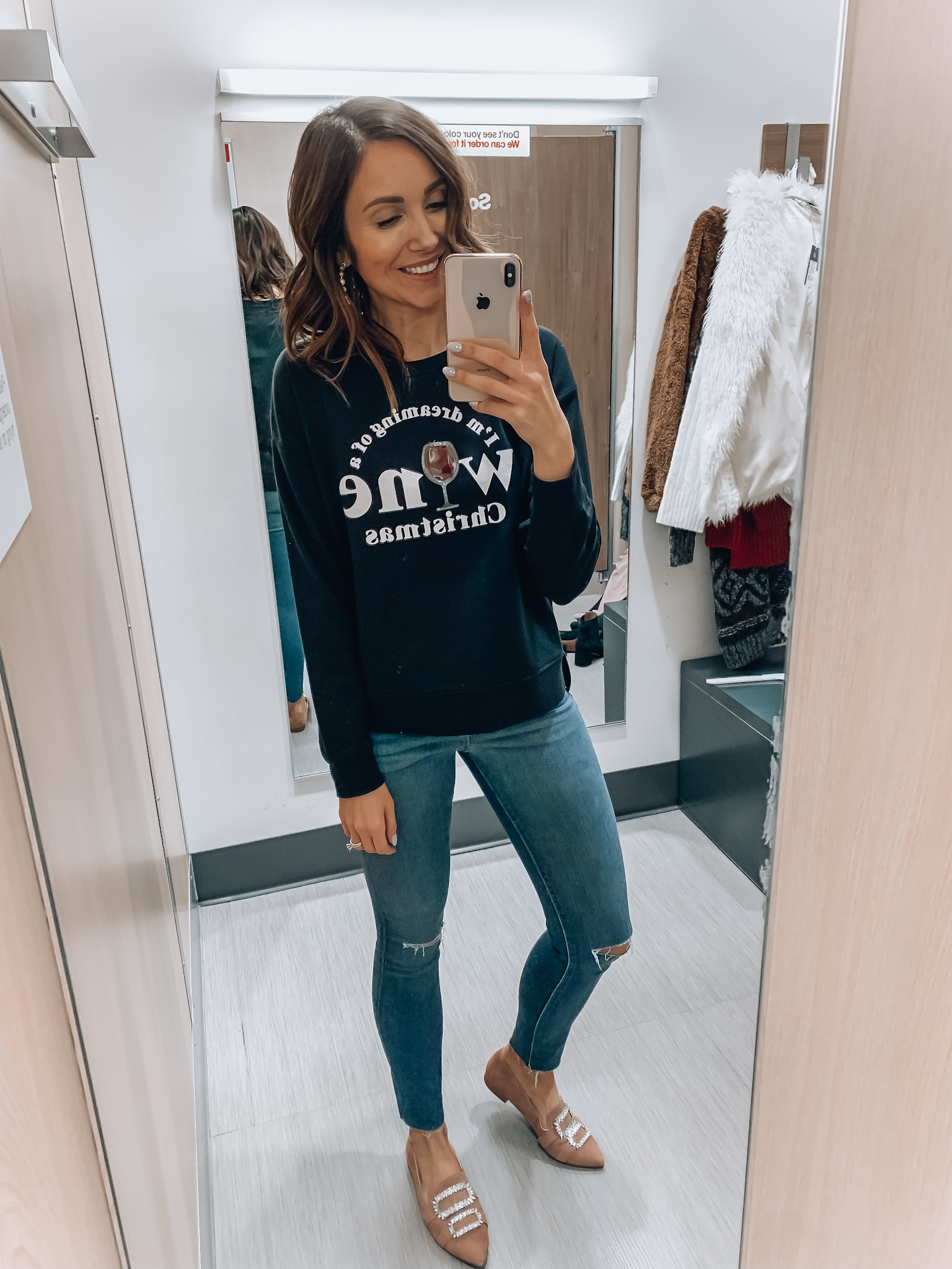 Woman wearing Christmas tee, and Jeans