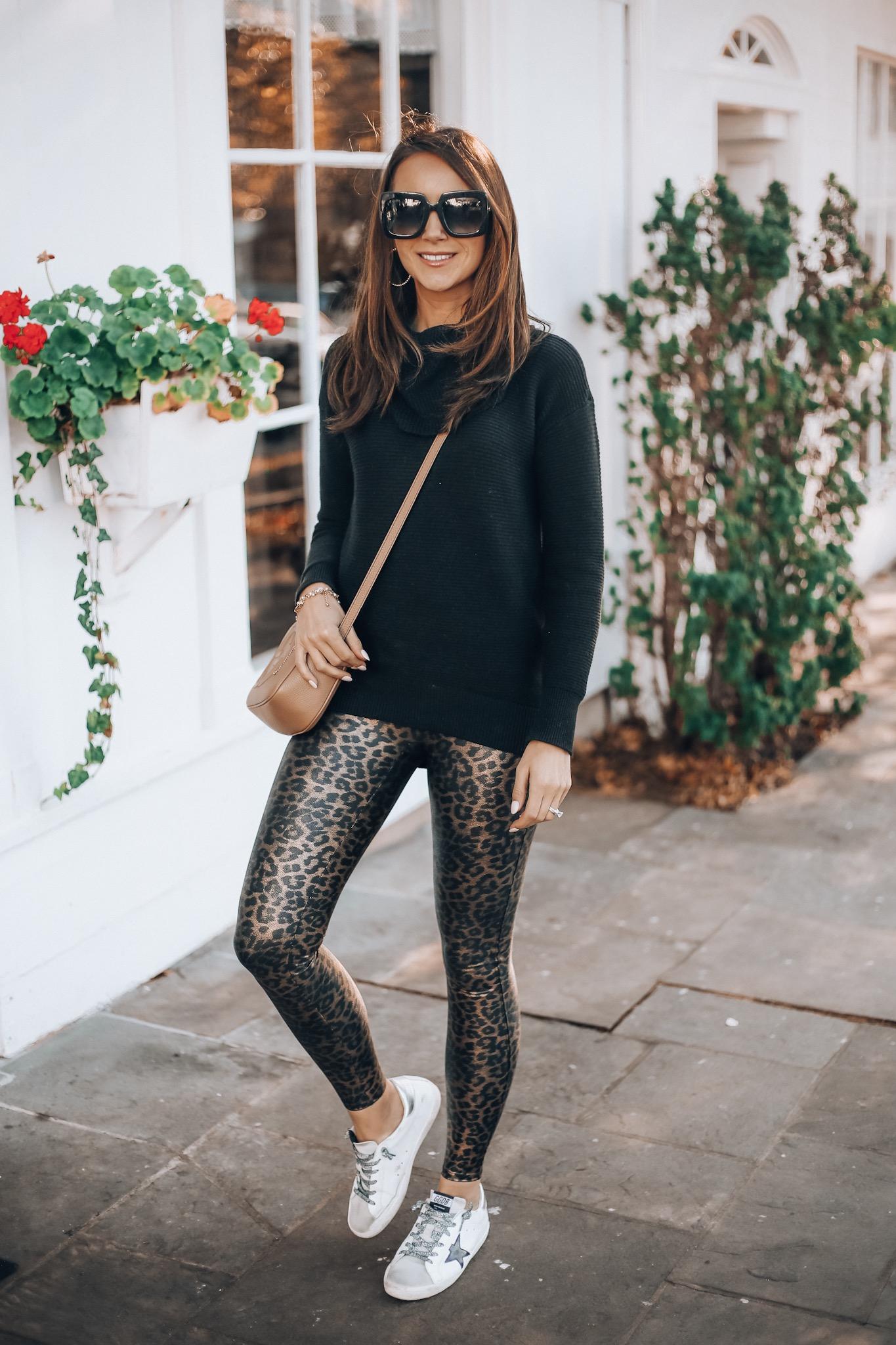woman wearing tunic, leopard leggings, golden goose sneakers