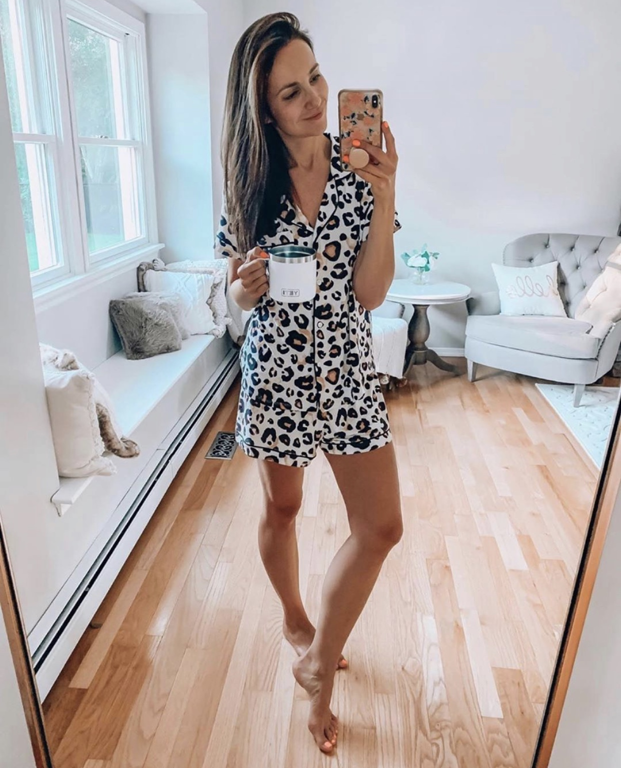 Woman wearing leopard print PJs