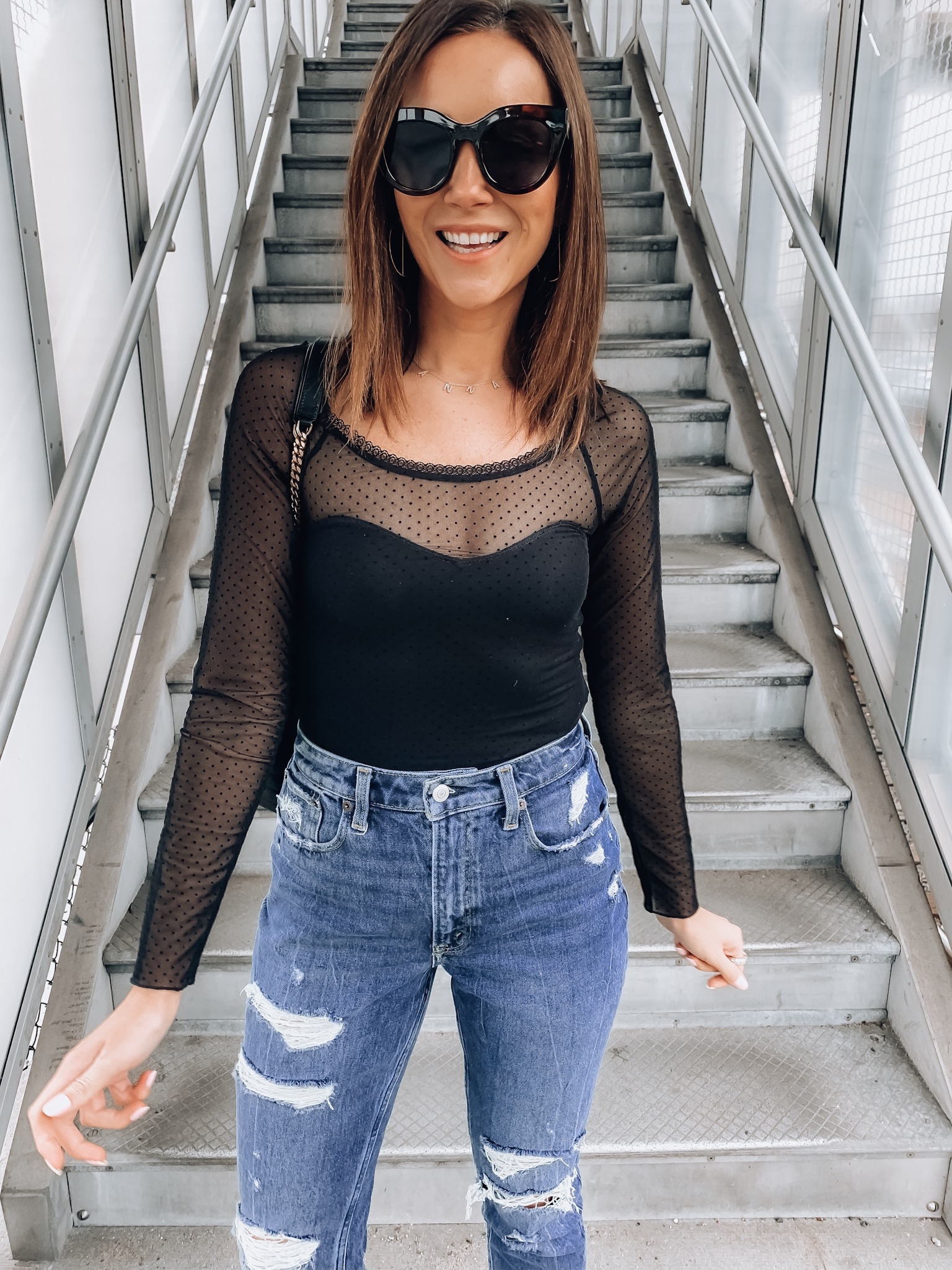 woman wearing le specs sunglasses