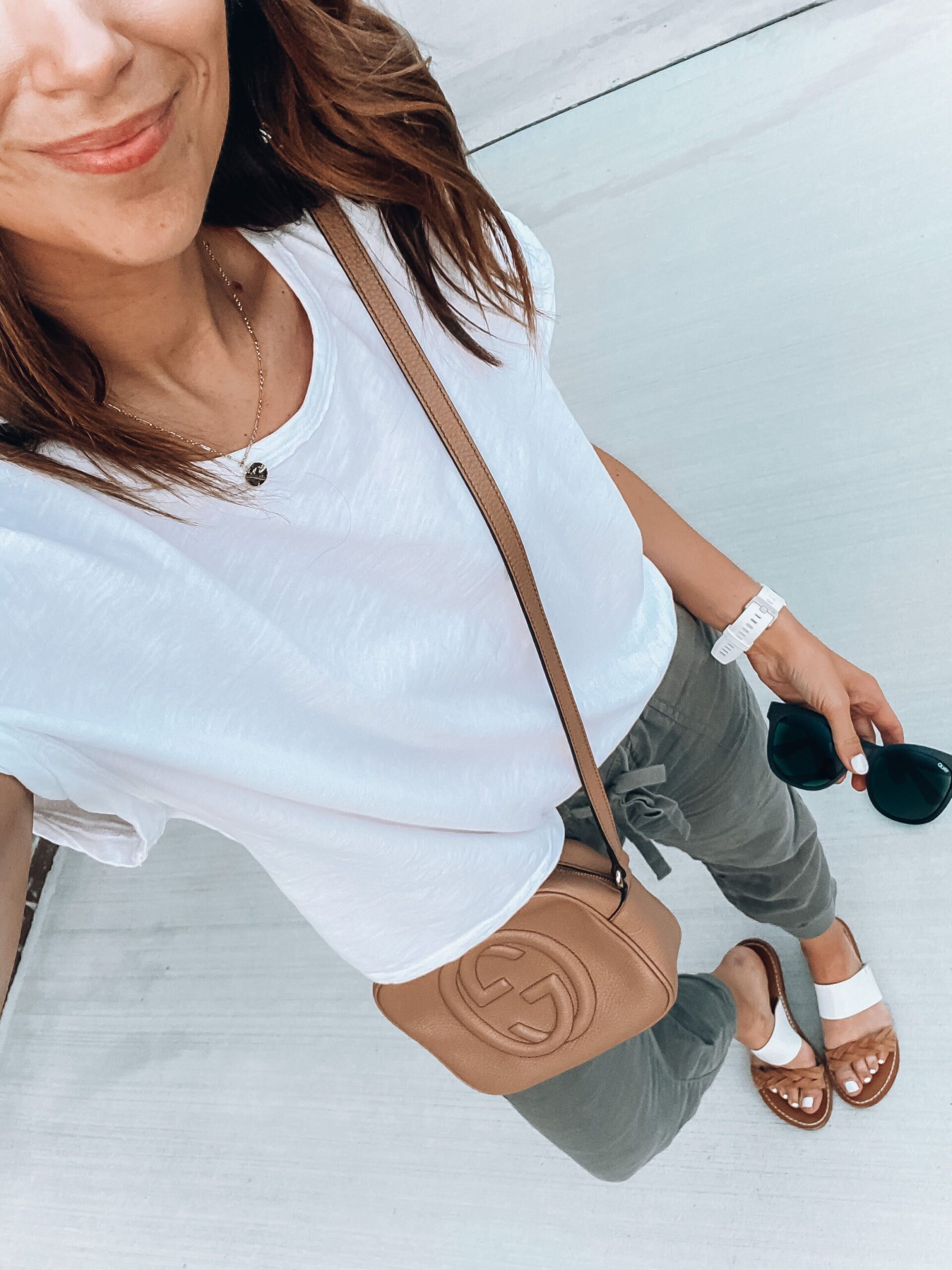 linen joggers white tee slides and sunglasses