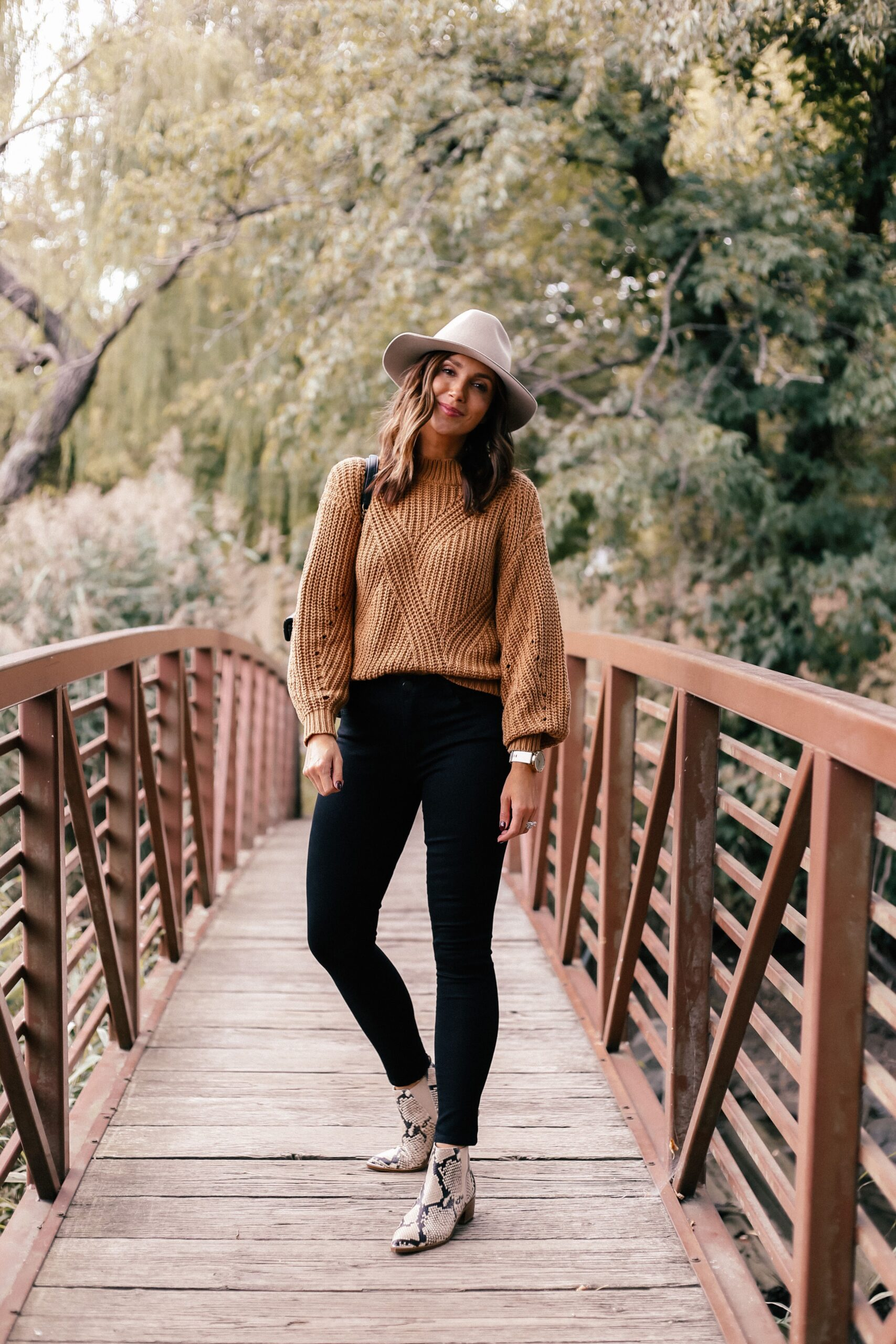 fall outfit with black jeans and brown sweater