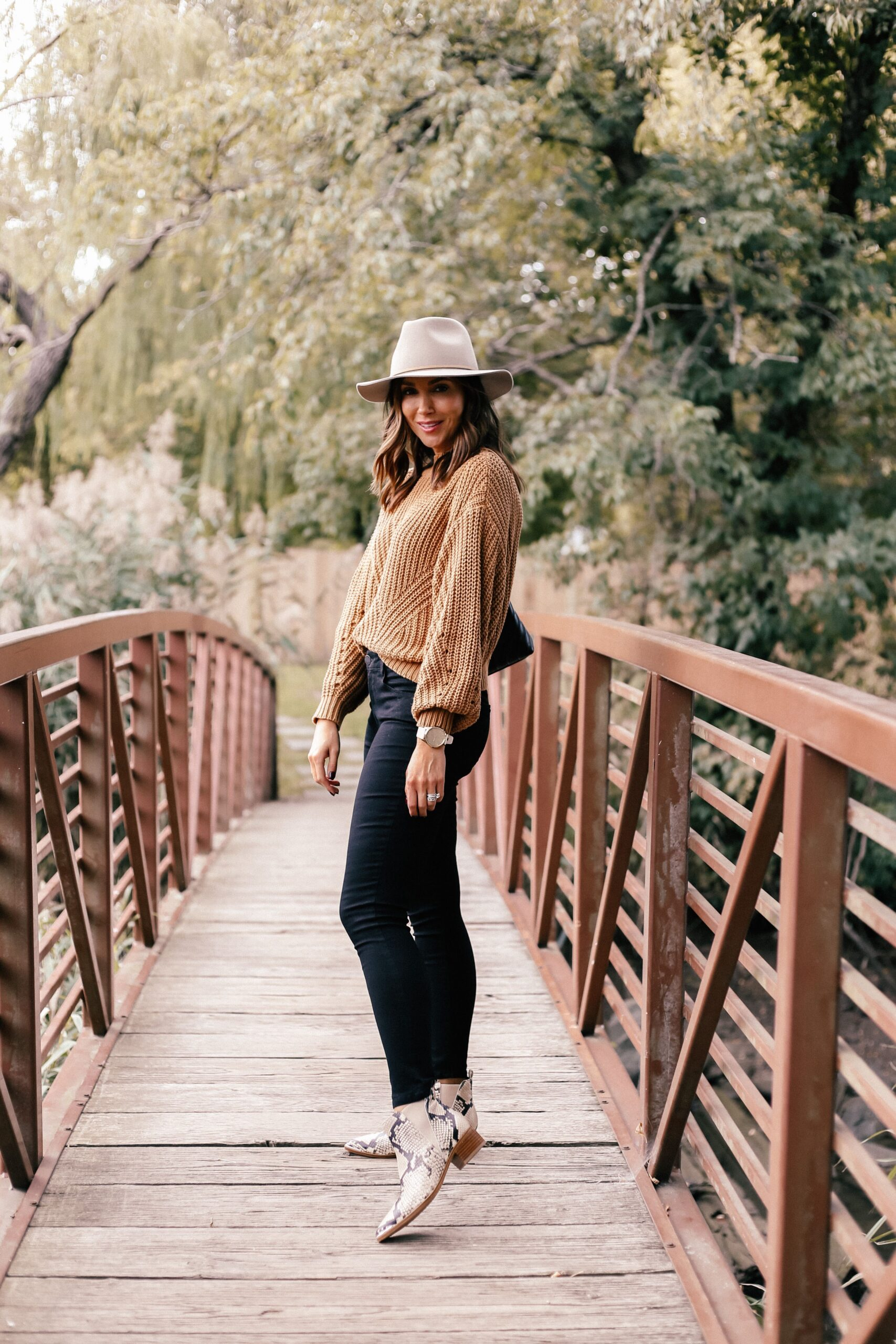 fall outfit idea with black jeans, snakeskin boots and hat