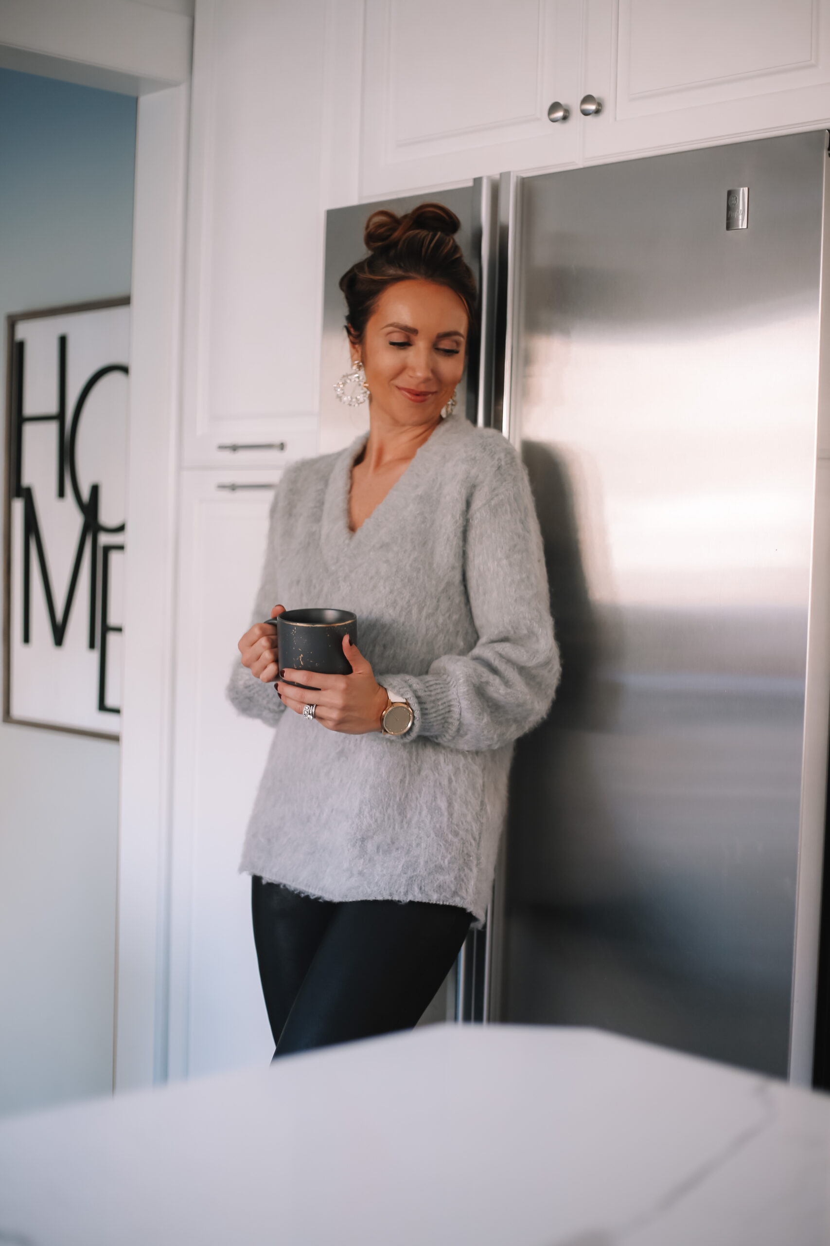 grey v neck sweater with faux leather leggings