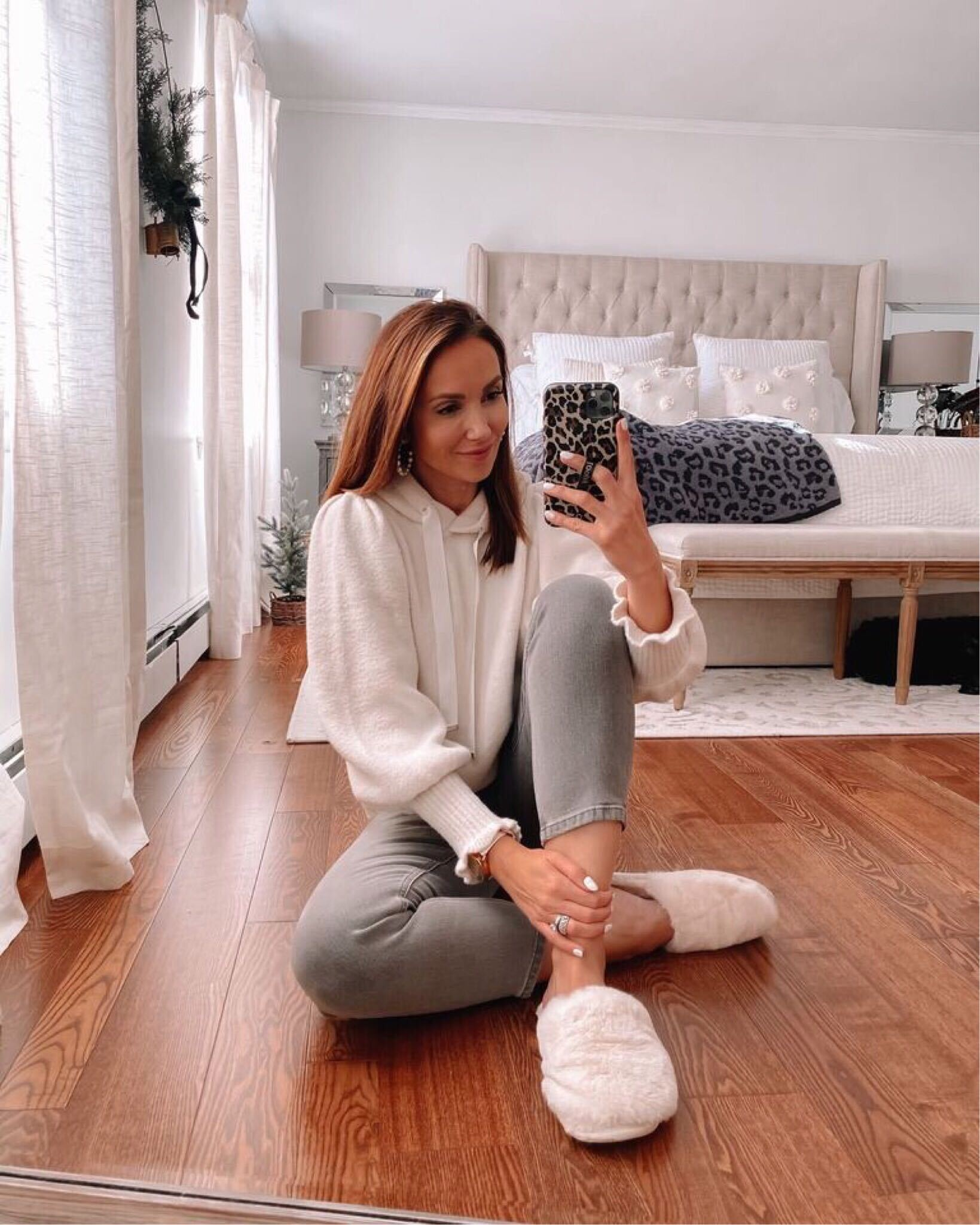 express white sweatshirt, grey jeans