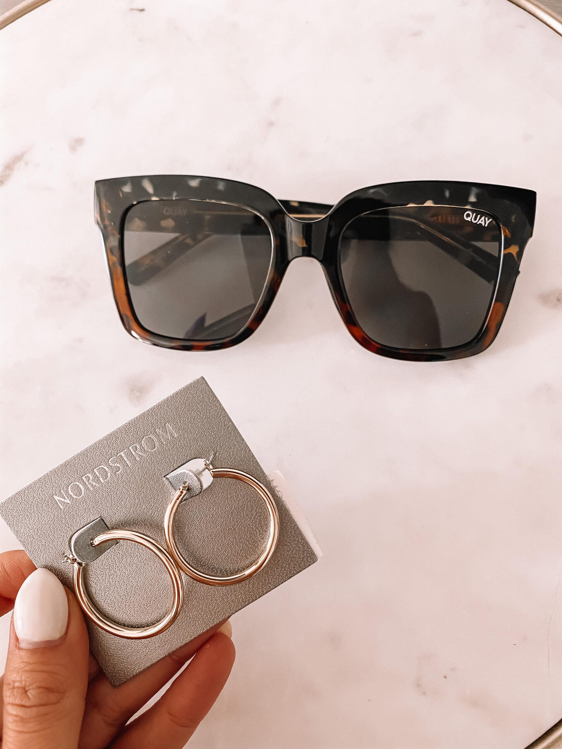 quay sunglasses and gold hoop earrings